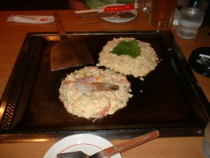 Halfmade shrimp and cheese Okonomiyaki Photo courtesy of Wikimedia Commons
