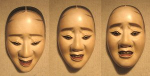 Three pictures of the same female mask showing how the expression changes with a tilting of the head. In these pictures, the mask was affixed to a wall with constant lighting, and only the camera moved.